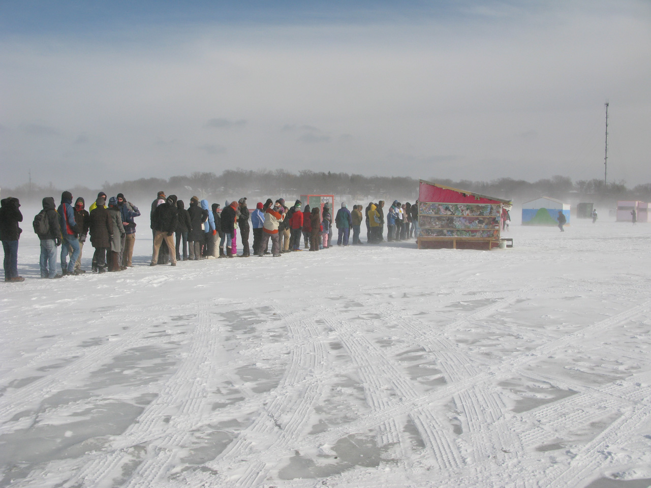 people lined up to break the world record for most people doing the bunny hop on a frozen lake – Art Shanty Projects