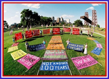 We make a peace sign of banners on Harriet Island