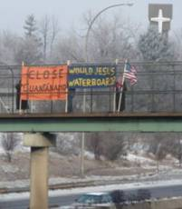 "Gateway bikepath bridge over I-35E–""Torture is wrong-Close Guantanamo"" on Gateway bikepath over 35E just north of St. Paul."